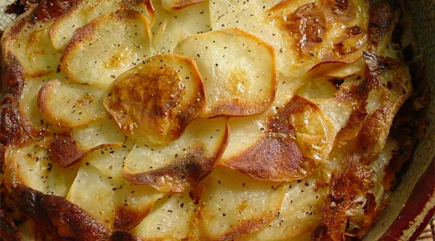 Recipe for Light Scalloped Potatoes - The problem with most scalloped potato recipes is the calories. This recipe is creamy, soft, thin, and light without all the fat and calories!