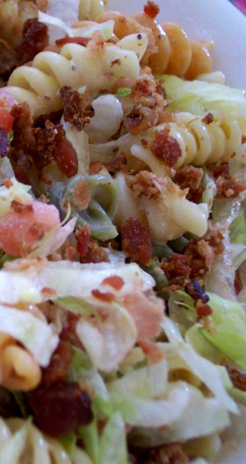 This is an easy and flavorful BLT Pasta Salad that I'm always asked to bring to potlucks. You can have it ready in under 20 minutes! It is really that easy. #pasta #bacon #pastasalad