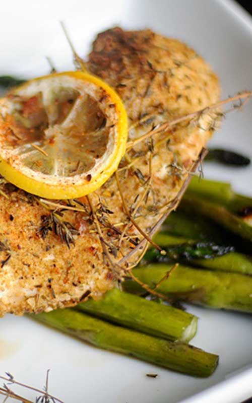 Recipe for Thyme Chicken with Garlic and Asparagus - Everyone needs a faultless recipe for roast chicken — here's yours. Savor this herb chicken recipe with an exotic flavor which is beyond words.