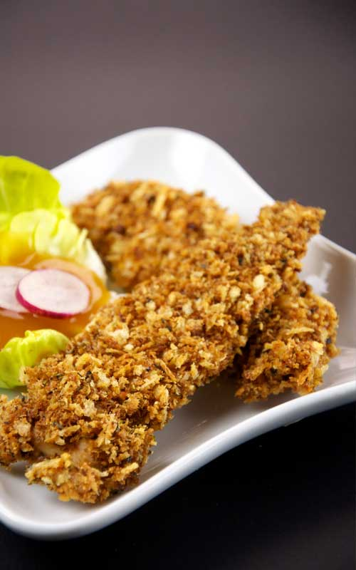 Recipe for Caribbean Coconut Chicken - This twist on the traditional coconut shrimp is sure to please. Try these crispy-salty-sweet tenders at your next party!Recipe for Caribbean Coconut Chicken - This twist on the traditional coconut shrimp is sure to please. Try these crispy-salty-sweet tenders at your next party!