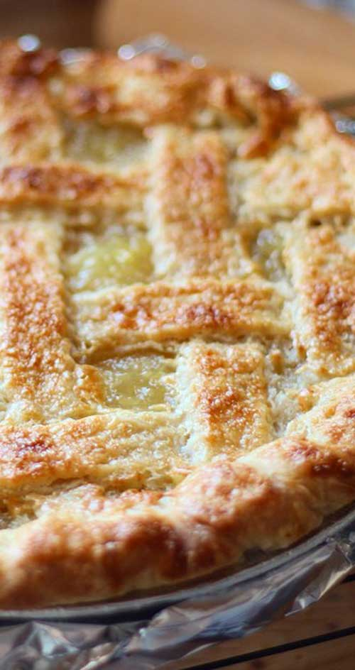 Move over, traditional apple pie. This zesty pineapple pie is a refreshing taste of the Islands that's apple-pie easy. #pie #desserts #pineapple