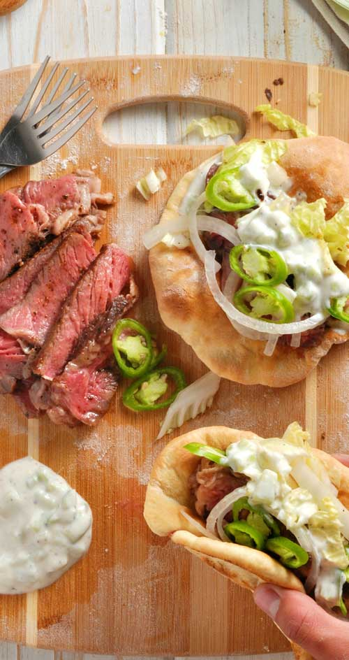 As summer peaks around the corner, you\'re going to want thisEasy Steak Gyros with Homemade Pitas recipe in your arsenal for those sunny beach day picnics. #gyros #greekfood #steak #pitas #sandwiches
