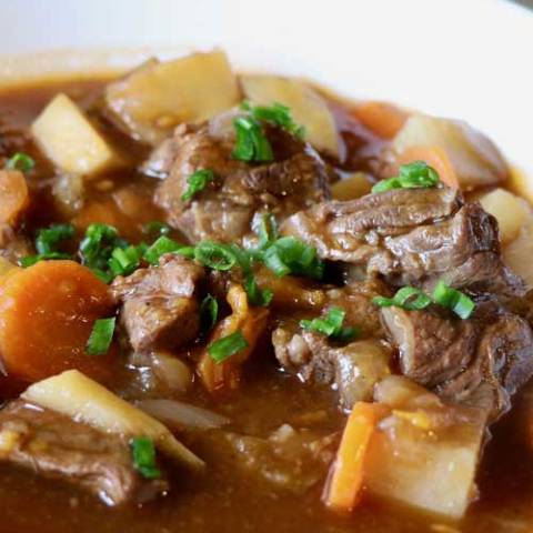 Recipe for Healthier Irish Beef Stew - This hearty and healthier Irish beef stew may be better for you, but it does not sacrifice any flavor. Simmering for about 2 hours makes the meat and vegetables fork tender and delicious.
