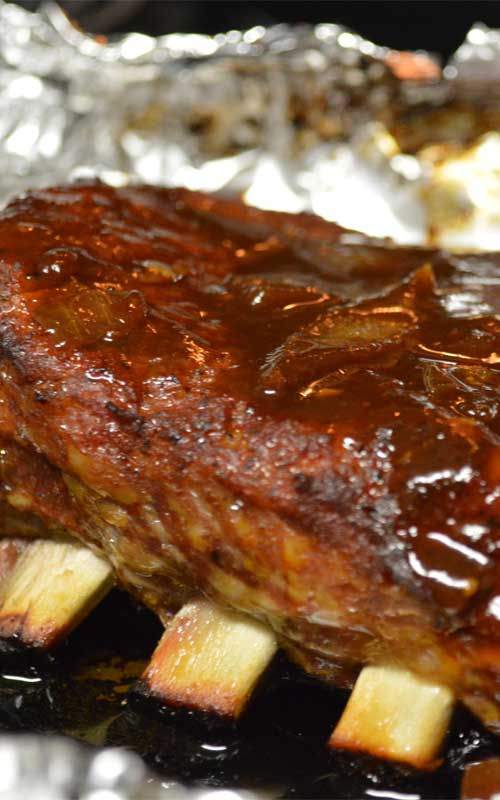Recipe forSweet & Sticky BBQ Ribs -It's really easy to get the low and slow smokehouse flavors of these Sweet & Sticky BBQ Ribs at home. With a spice rub, some time, and BBQ sauce, you will be devouring the best ribs in town.
