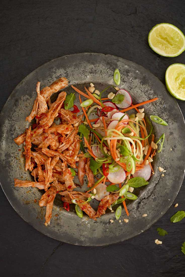 Delicious shredded pork with a Thai flavor you will not be able to stop eating. This Thai Pulled Pork With Asian Slaw has layers of flavor and makes for the perfect easy, no effort Thai feast! #thai #pork #asian #dinnerideas