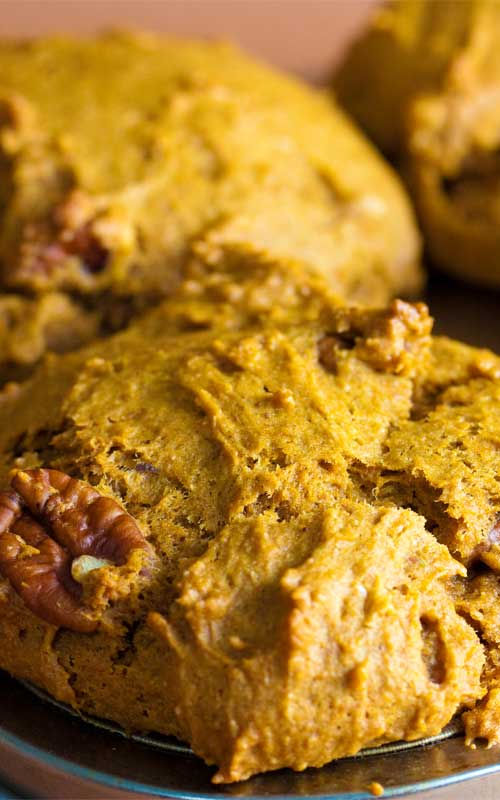 This Vegan Pumpkin Spice Muffin recipe has a wonderful warm, buttery flavor that tastes just like fall. So perfectly soft, moist, dense and delicate that you may just want them every time of year!