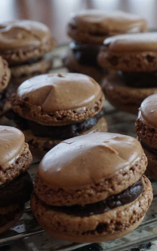 Whip up a batch of these French Chocolate Macarons and pretend that you are taking a trip to Paris. You will fall in love with these crisp chocolate cookies and their luscious creamy ganache filling.