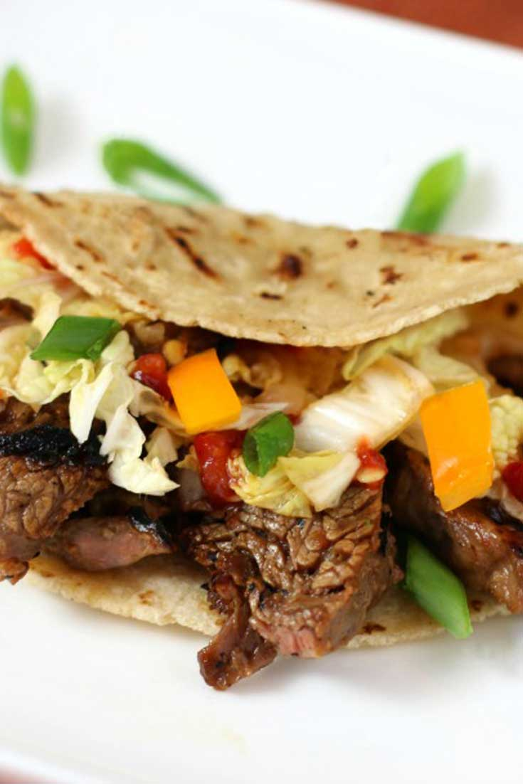These Korean Style Beef Tacos are the perfect sweet and sour, tasty, speedy dinner to delight your taste buds any day of the week. #steak #tacos #korean #fusion #dinnerideas