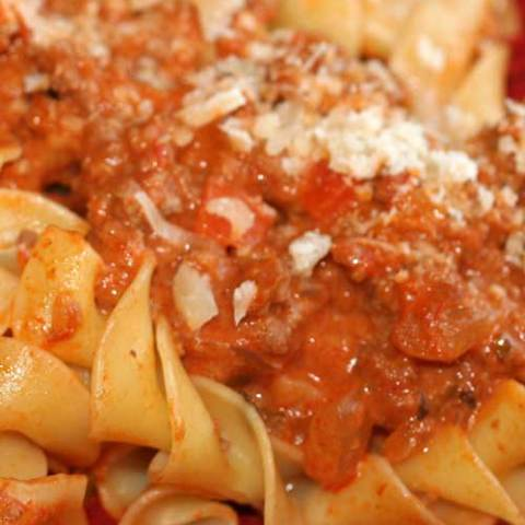 A thick, rich meat sauce with great depth of flavor. Made in under an hour, this is a Pasta Bolognese recipe that you will make over and over again!