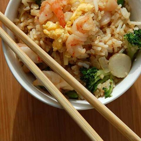 This super easy Shrimp Fried Rice is loaded with shrimp and veggies, all tossed in a perfectly balanced sauce. Ready in less than 30 minutes, this may be your next go-to dinner recipe that they can't get enough of!