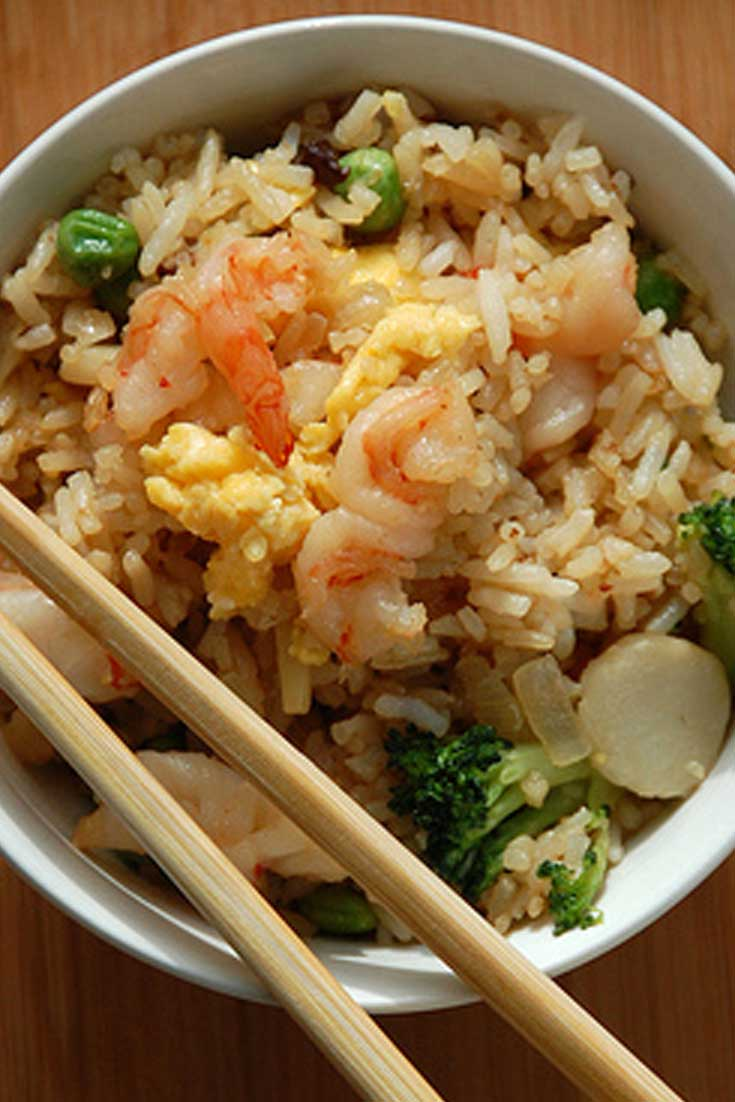 This super easy Shrimp Fried Rice is loaded with shrimp and veggies, all tossed in a perfectly balanced sauce. Ready in less than 30 minutes, this may be your next go-to dinner recipe that they can't get enough of! #rice #shrimp #asian #dinnerideas