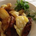 Roast potatoes prepared on wood burning grill at L'Ovile Restaurant in Sacrofano