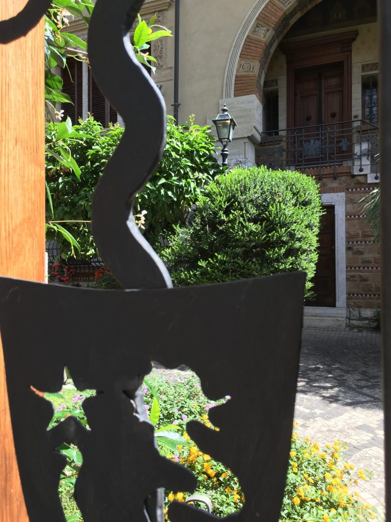 Seahorse design in Fairy Cottages gate, Quartière Coppedé