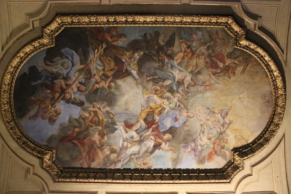 Basilica Santa Cecilia nave ceiling vault shows the Coronation of St Cecilia in Heaven and was painted by Sebastiano Conca around 1727.