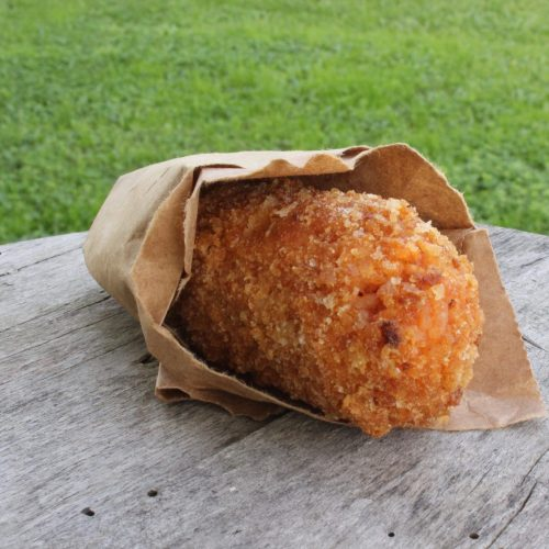 Luscious meat and cheese stuffed rice balls