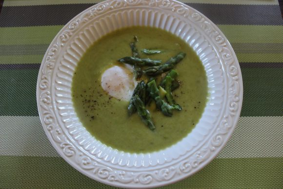 Creamy asparagus soup with poached eggs