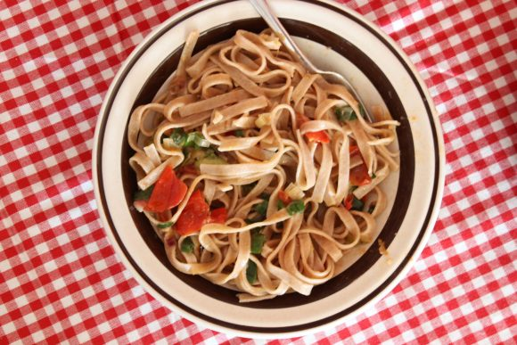 Green onion and tomato fettuccine, made with a touch of peperoncino. A few anchovy fillets give it a hidden, magical flavor