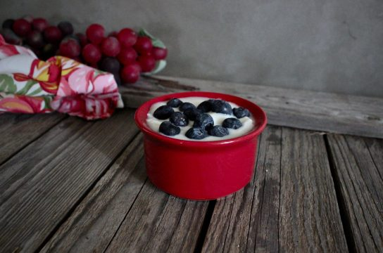 Delicious homemade yogurt, topped with blueberries