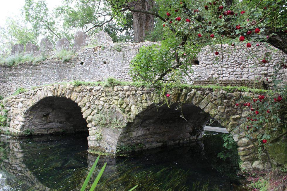 Ruins of a small stone bridge in the Ninfa Gardens