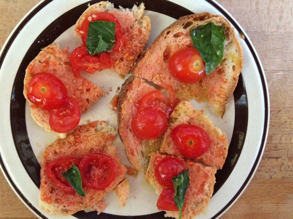 Bread and Tomato Appetizer drizzled with olive oil