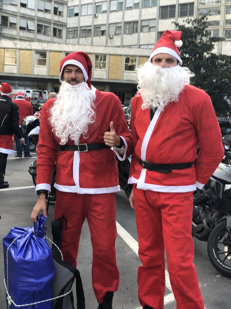 Volunteers dressed as Santa Claus visit one of Romes largest hospitals, Gemelli, to bring gifts to the patients
