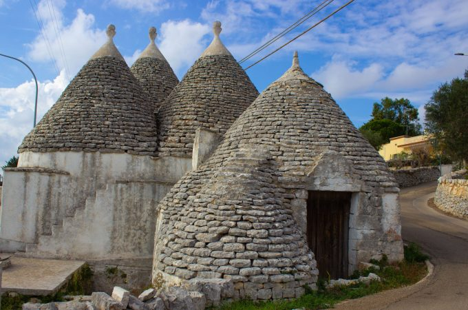 Trulli are a classical conical-shaped adobe in the Puglia region