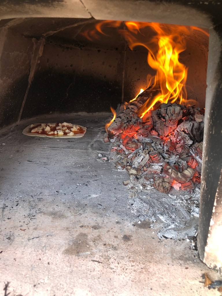 Homemade Pizza in a wood-burning oven