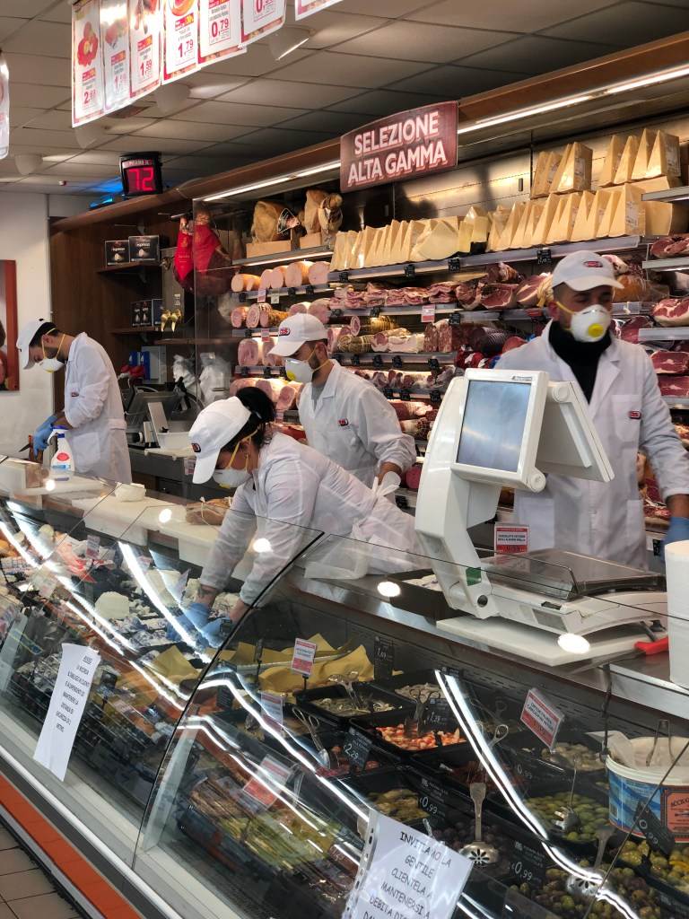 Gloved and masked grocery store employees