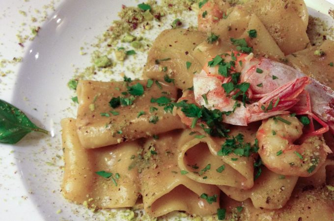 Delicious paccheri with a creamy seafood sauce and pistachios in Palermo