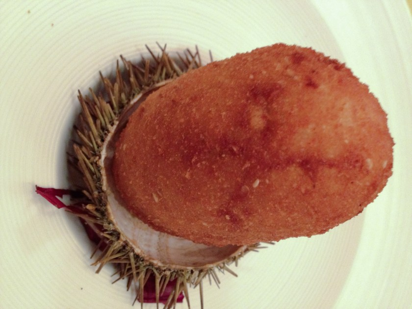 An arancina - delectable deep-fried rice ball - in Palermo stuffed with sea urchins and served atop a sea urchin shell