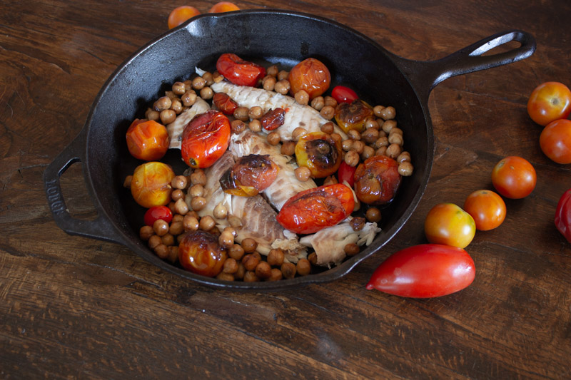 Pan seared Sea-bass with cherry tomatoes and chickpeas