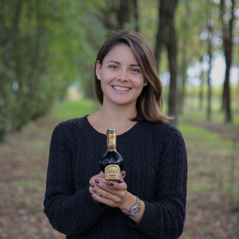 Sofia Malagoli and a bottle of DOP balsamic vinegar