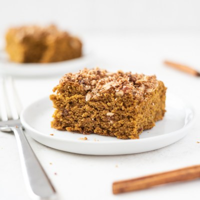 Piece of pumpkin coffee cake on a white plate