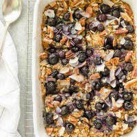blueberry morning glory baked oatmeal in white baking dish