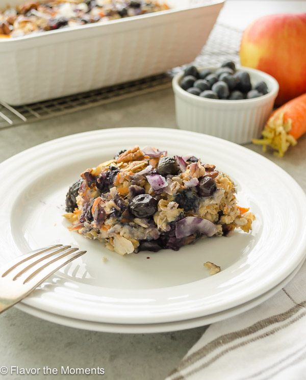 Serving of blueberry morning glory baked oatmeal on a white plate