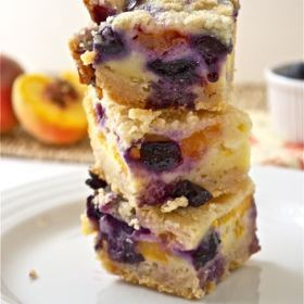 blueberry peach pie bars stacked up