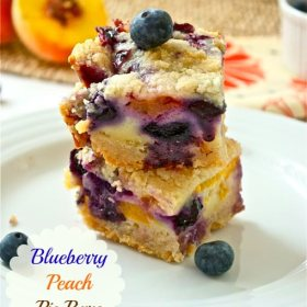 stack of blueberry peach pie bars with blueberry on top