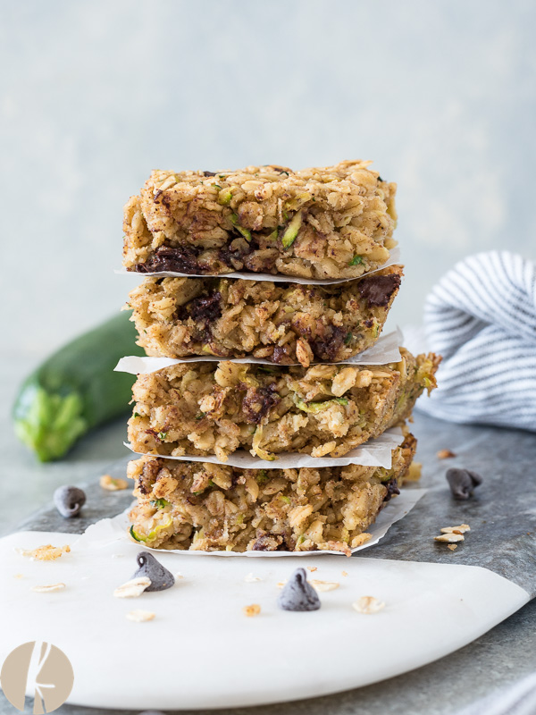 Oatmeal Zucchini Snack Bars are wholesome, hearty gluten-free bars packed with oats, zucchini and chocolate chips!