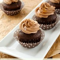 Chocolate cupcakes with salted caramel frosting on a white plate