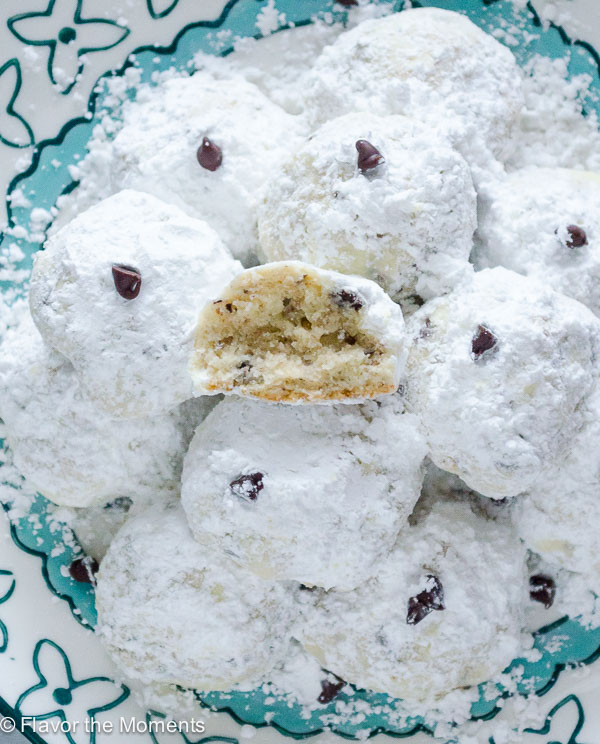 Chocolate Chip Hazelnut Snowball Cookies are buttery snowball cookies with the nuttiness of ground hazelnuts and chocolate chips! @FlavortheMoment