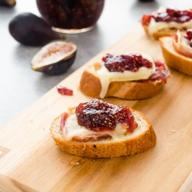 Brie, Fig Jam and Serrano Ham Crostini is an elegant appetizer that you can put together in mere minutes with only 4 ingredients!