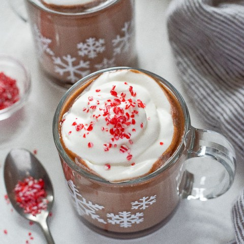 Slow Cooker Peppermint Hot Chocolate is the easy way to prepare rich, creamy hot chocolate.  Top with whipped cream or marshmallows and crushed candy canes!