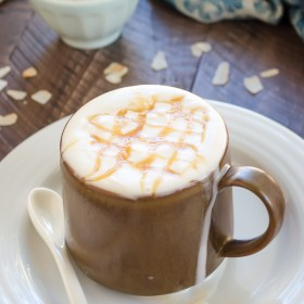coconut milk macchiato with caramel drizzle