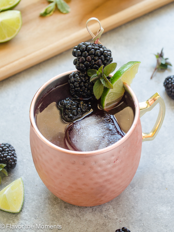 Blackberry Moscow Mule is an easy cocktail with spicy ginger beer, vodka, lime juice, and juicy muddled blackberries. It's so refreshing a perfect for summer sipping! @FlavortheMoment