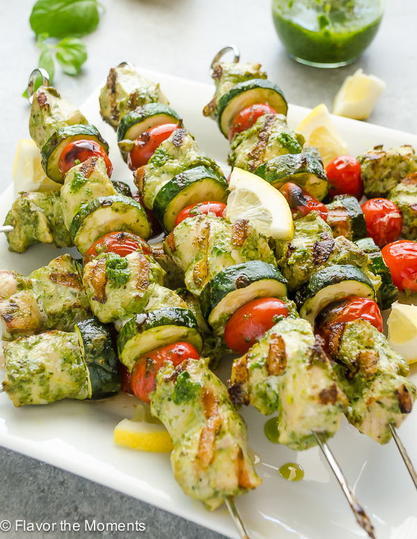 Grilled Lemon Pesto Chicken Kebabs are lemon pesto marinated chunks of chicken skewered with tomatoes and zucchini. It's a summer meal that's ready in minutes!