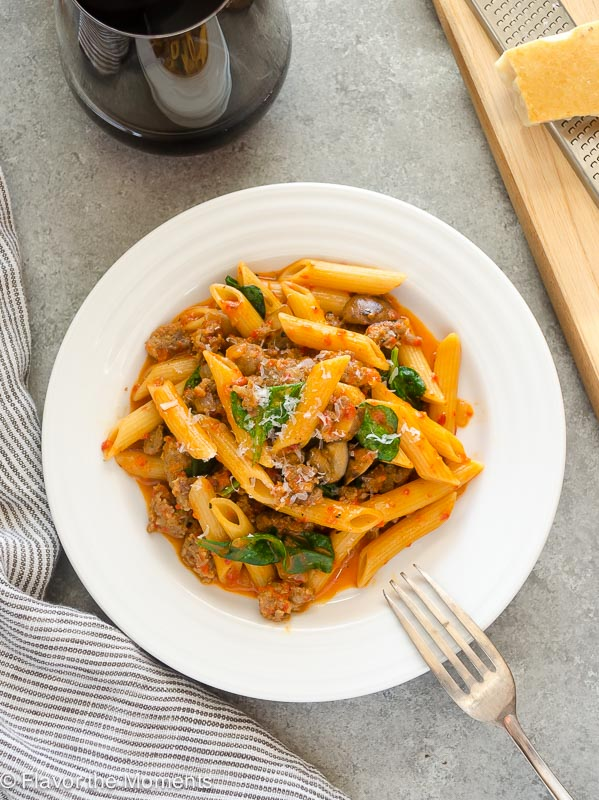 One Pot Creamy Sausage Roasted Red Pepper Pasta is ultra creamy and bursting with flavor! This recipe comes together in 30 minutes and is perfect for busy weeknights and entertaining! @FlavortheMoment