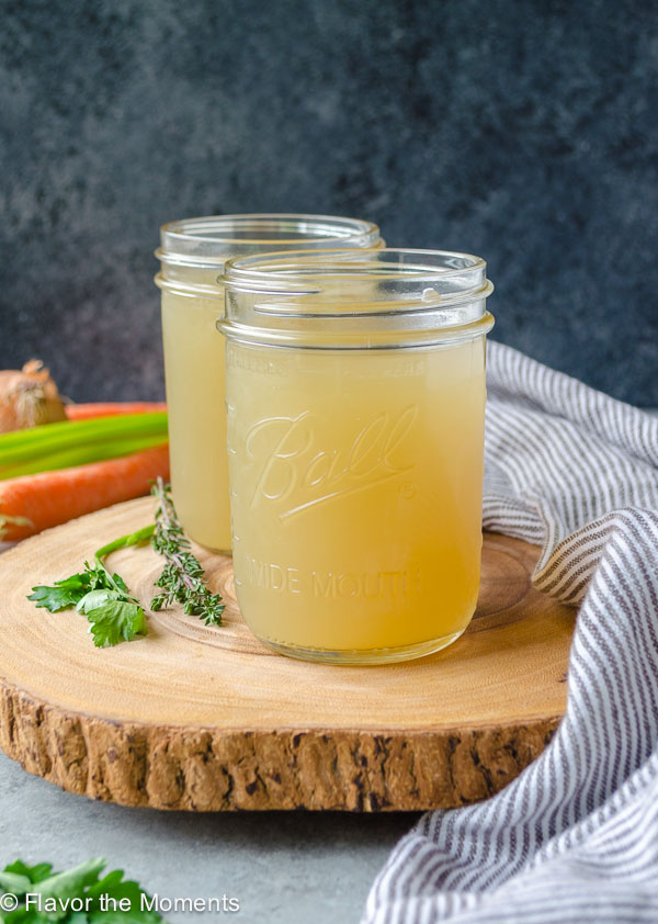 Slow Cooker Homemade Chicken Stock is the dump it and forget it way to make homemade chicken stock. It's so easy and so much better than store bought! @FlavortheMoment