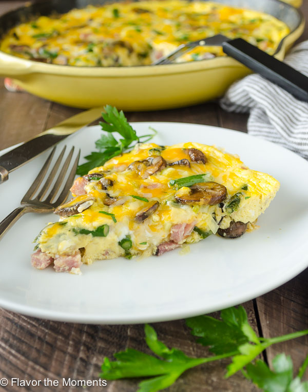 Ham, Asparagus, and Mushroom Frittata is packed with spring veggies, diced ham, and plenty of cheese. It's perfect breakfast, brunch, or brinner! @FlavortheMoment