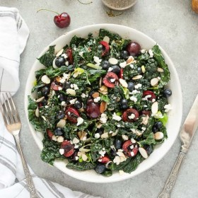 Summer Kale Salad with Blueberries, Cherries, and Goat Cheese is an addicting superfood salad tossed in a balsamic maple vinaigrette! #summer #kale #salad #superfood #blueberries #cherries #goatcheese #healthy #recipes