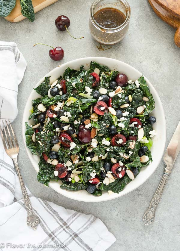 Summer Kale Salad with Blueberries, Cherries, and Goat Cheese is an addicting superfood salad tossed in a balsamic maple vinaigrette! @FlavortheMoment
